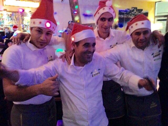 The very happy and festively attired waiters !!